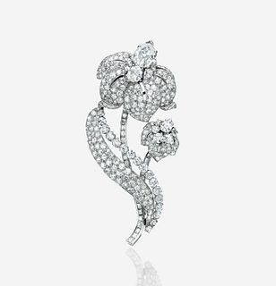 A diamond and platinum clip brooch, Cartier London