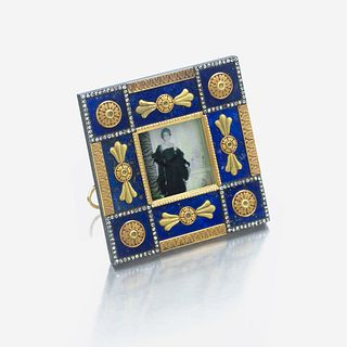A bicolored gold-mounted lapis lazuli and diamond miniature picture frame, Fabergé marked Fabergé, workmaster's mark of Henrik Wigström, c. 1890