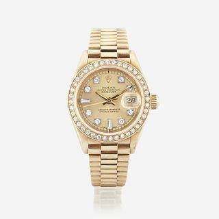 An eighteen karat gold and diamond, automatic, bracelet wristwatch with date