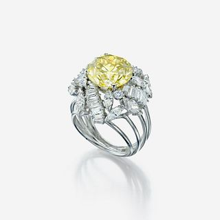 A colored diamond, diamond, and eighteen karat white gold ring