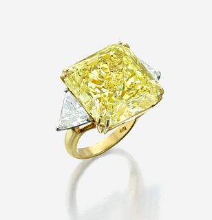 An impressive fancy light yellow diamond ring