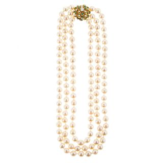 A Triple Strand of Pearls with 14K Diamond Clasp