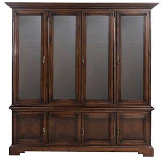 Vitrina. Siglo XX. En talla de madera. A 2 cuerpos. Con 8 puertas abatibles, 4 con cristal y soportes tipo braquet. 220 x 218 x 51 cm