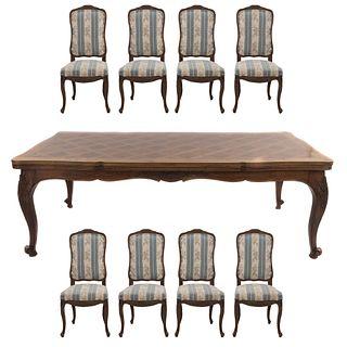 Comedor. Siglo XX. En talla de madera. Consta de: mesa y 8 sillas. 78 x 222 x 104 cm Piezas: 9
