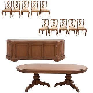 Comedor. Siglo XX. En talla de madera. Consta de: Mesa, trinchador y 10 sillas.  Piezas: 12
