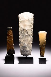 A Group of Three Scandinavian Neolithic Stone Tools Height of tallest 13 1/2 inches.