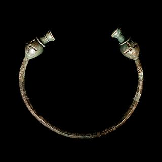 A Celtic Bronze Torc with Poppy-Head Terminals   Width 7 1/2 inches.