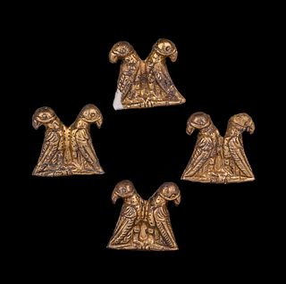 Four Thracian Gilt-Silver Double Eagle Plaques Height of each 15/16 inches.