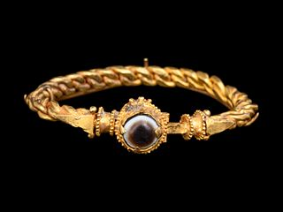 A Byzantine Solid Gold Bracelet with Agate Cabochon Diameter 2 3/4 inches.