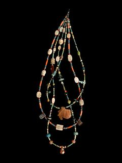 An Egyptian Stone and Faience Necklace Length 14 inches.