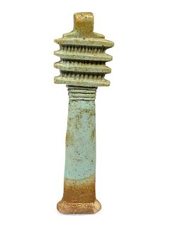 An Egyptian Faience Djed Pillar Height 3 3/4 inches.