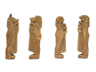 Four Egyptian Faience Amulets Height of each 3 1/4 inches.