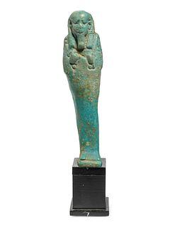 An Egyptian Faience Ushabti Height 4 inches.