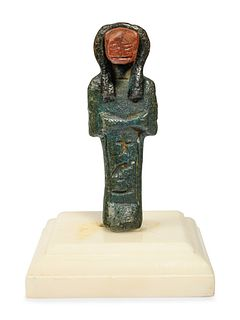 An Egyptian Composite Faience Sekhmet Height 3 1/2 inches.
