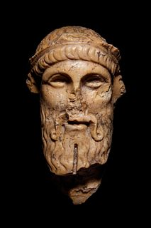A Roman Giallo Antico Marble Herm Head of Dionysos Height 6 inches.