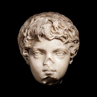 A Roman Marble Portrait Head of the Young Caracalla Height 9 1/4 inches.