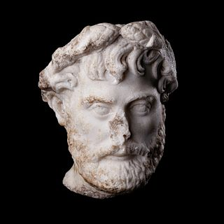 A Roman Marble Portrait Head of Herodes Atticus Height 11 inches.