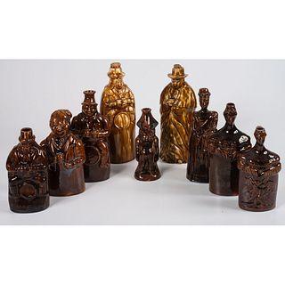 Nine Figural Flasks in Brown Glaze