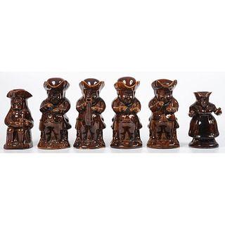 Six Toby Pitchers in Dark Brown Glaze
