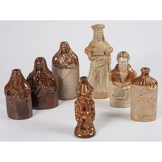 Seven Figural Stoneware Flasks