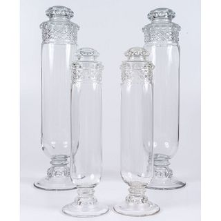 A Set of Four Pressed Glass Apothecary Display Jars