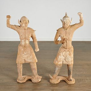 Pair large Chinese pottery guardian figures