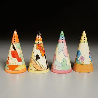 Clarice Cliff, four Staffordshire shakers