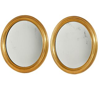 Pair English brass oval convex mirrors