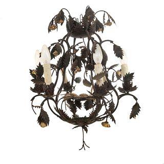 Candil. Siglo XX. Elaborado en hierro forjado. Para 6 luces. Con arandelas vegetales y brazos semicurvos. 64 cm altura