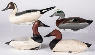 Four carved and painted duck decoys.