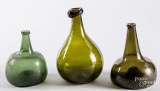 Two blown olive glass squat bottles, late 18th c.