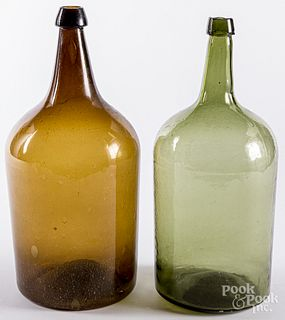 Two large antique glass bottles