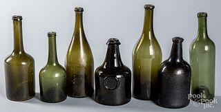 Six antique glass wine bottles, etc.