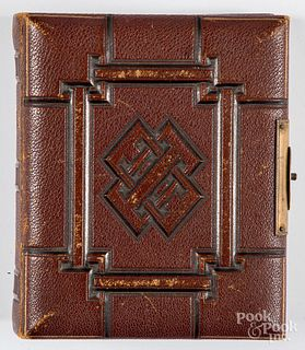 Early photograph album with CDVs and tintypes.
