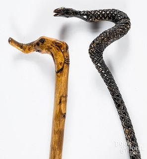 Two folk art carved canes