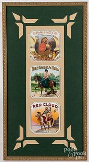 Three framed cigar labels