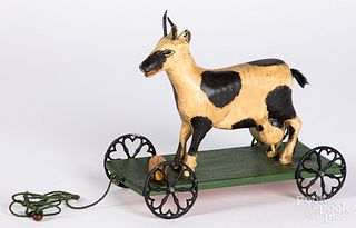 Walter Gottshall carved cow pull toy