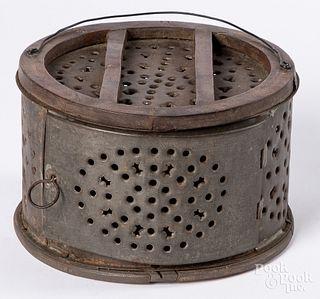 Unusual circular tin and walnut footwarmer