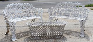 An Antique Pair Of Cast Iron Benches Together