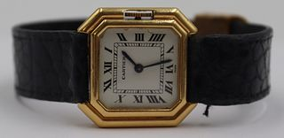 JEWELRY. Ladies Cartier Ceinture 18kt Gold Watch.