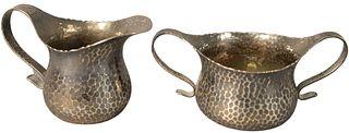 Tiffany and Company Sterling Silver Sugar Bowl and Creamer, both having hand-hammered finish and scrolling handles, both marked 'Tiffany and Company 6
