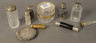 Group of Sterling Silver to include a compact; double sided perfume; two bottles with sterling tops; silver overlay bottle; along with a small perfume