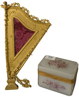 Two Piece Lot to include an opaline and brass mounted box, having painted floral and foliate decoration; along with a gilt bronze harp form frame, mar