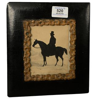 """Framed 19th Century Silhouette of a man in a top hat on horseback, signed and inscribed indistinctly along the lower edge, sight size 4 1/2"""" x 3 1/2""""."""