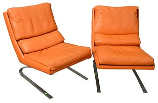 Pair of Mid-century Leather Upholstered Chairs set on chrome bases, height 31 inches.