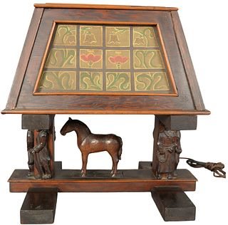Arts and Crafts Figural Table Lamp having carved horse and figures on base with painted mesh screen and rectangle shade.