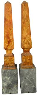 Pair of Orange Painted Wooden Obelisks mounted on green hardstone bases, height 35 inches, width 5 3/4 inches, depth 6 inches.
