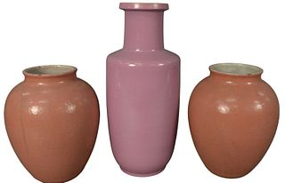 Three Piece Group of Chinese Porcelain Vases, to include a pair of pink crackle glazed vases, along with a purple glazed vase, each unmarked, heights