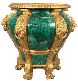 English Faux Malachite Gilt Decorated Jardiniere having lion form handles ending in paw feet, height 18 inches, diameter 15 1/2 inches.