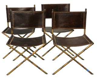 Set of Four Leather Chairs having faux brass metal frames, height 34 inches, width 23 inches.